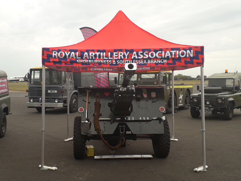 Printed gazebo canopy covering a military vehicle