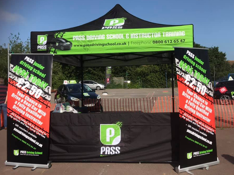 Pass Driving School gazebo at outdoor event