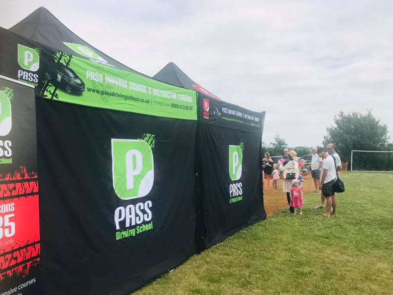 Pass Driving School gazebo rear wall at outdoor event