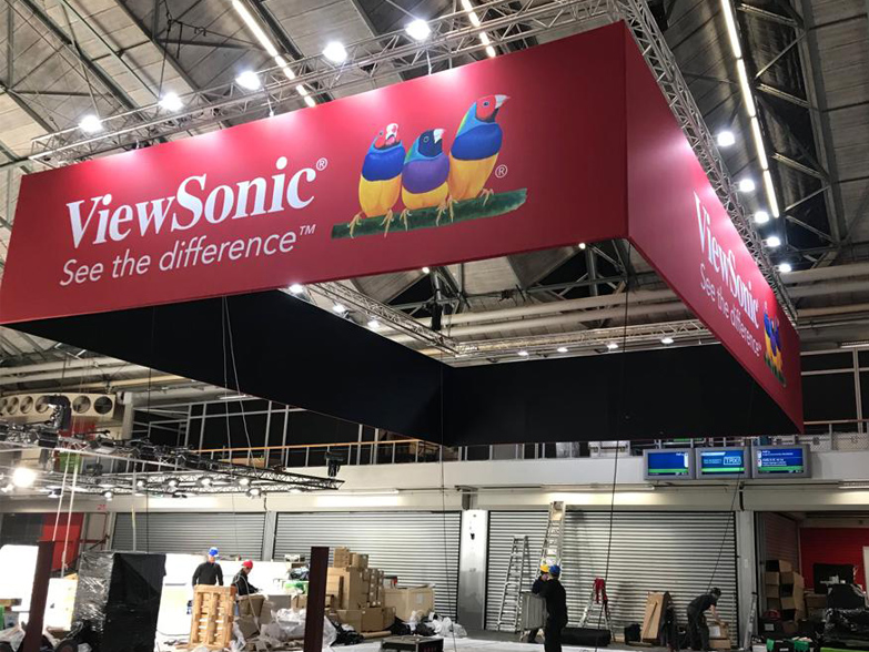 Large printed Hanging Banner being lifted into event space